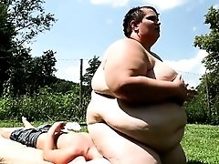 The fattest woman on earth sits on boy's face
